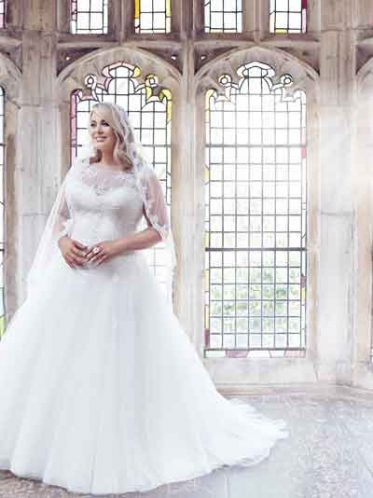Plus size wedding dress with illusion neckline