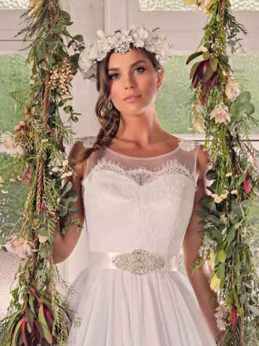 Bridal gowns in a floral setting