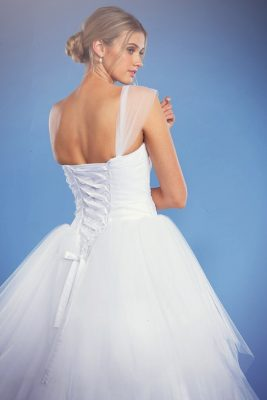 Ashley white debutante dress with lace up corset back and full skirt.