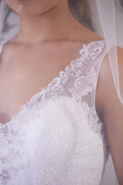 Veils over lace back wedding dress detail