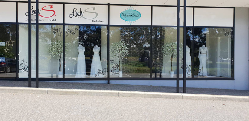 Wedding dresses in Front window at Leah S Designs