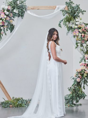 Add a long veil to compliment your halterneck style
