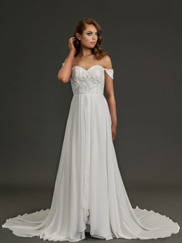 Simple flowing wedding dress with delicate design
