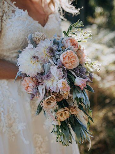 Blush A-line wedding flowers