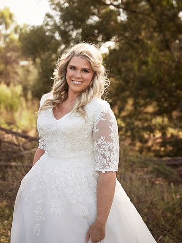 Curvy bride lace sleeve gown