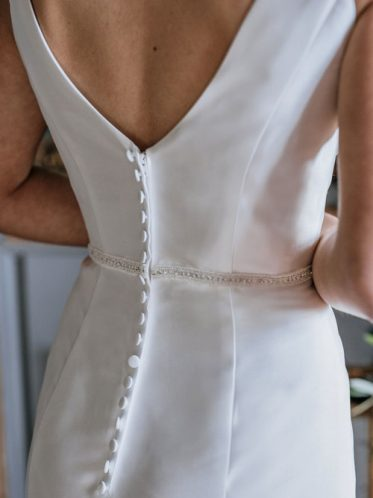 Button on back of satin wedding dress